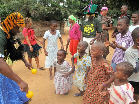 Kids dancing with joy at the Big Little Caravan of Joy event held in Dagbamete in 2011