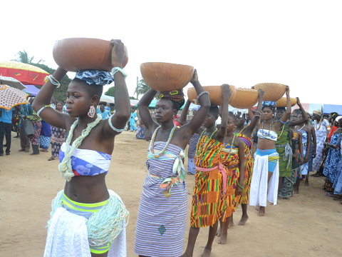 Women Carrying Traditional Items